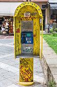 Thessaloniki, Greece - August 16, 2018: Old public phone in Thessaloniki, Greece