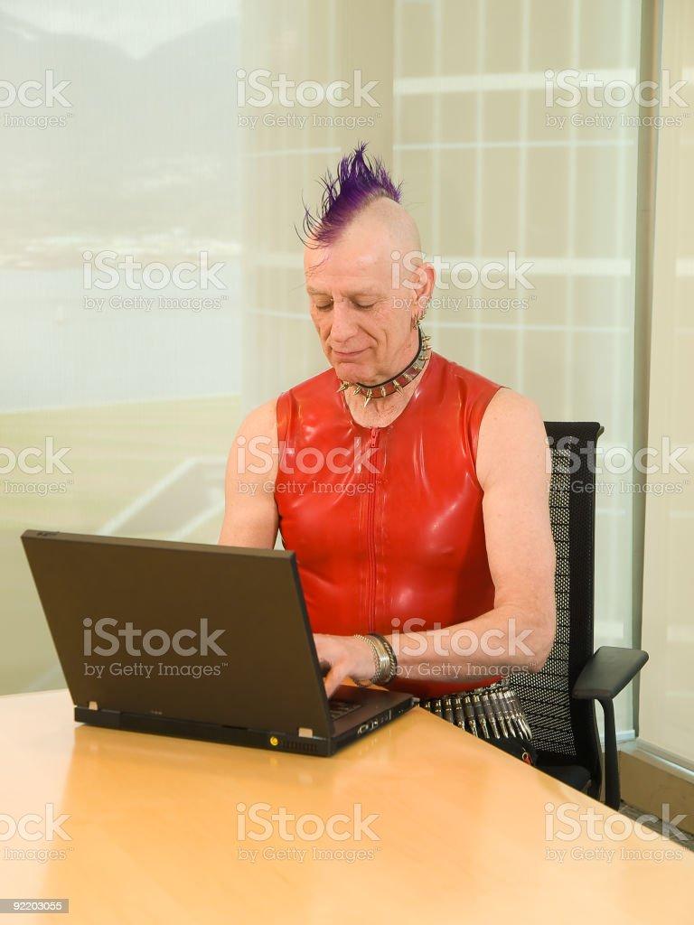 Old Punk Rocker Using Laptop stock photo