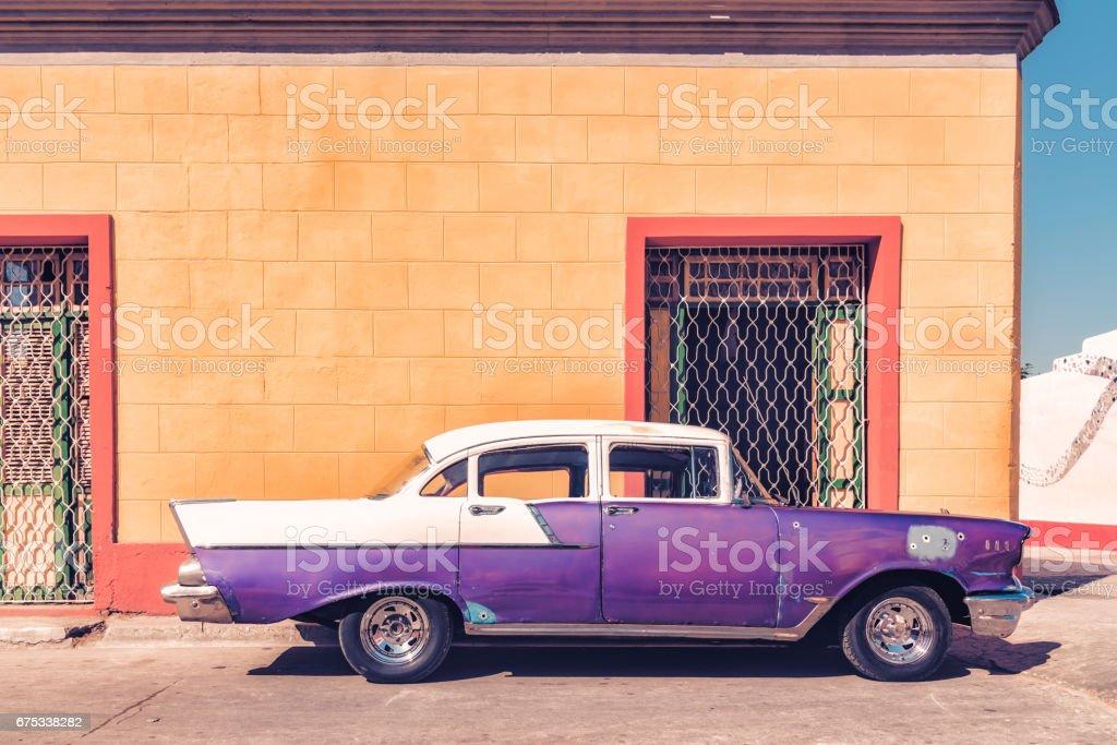 old purple vintage car in the streets of Santiago de Cuba stock photo