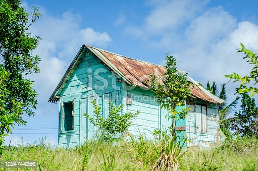 old quaint wooden chattel house on a hill