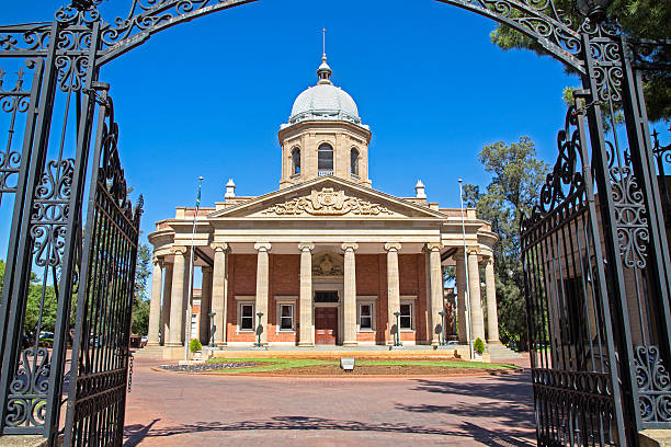 Old Raadsaal in Bloemfontein from the gate stock photo