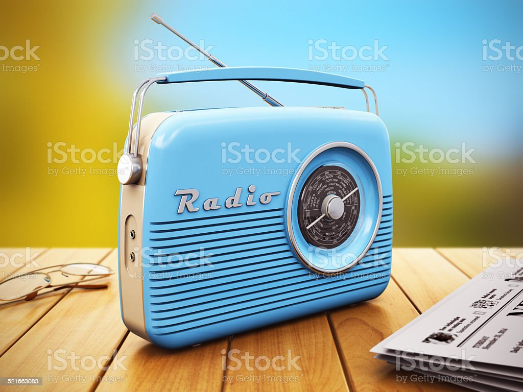 Old radio on wooden table outdoors stock photo