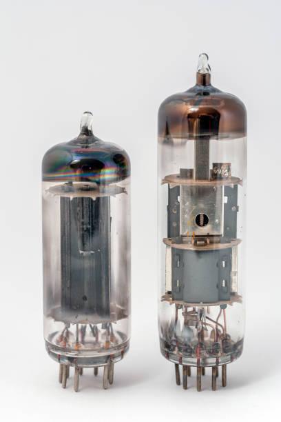 Old radio tubes on white background stock photo