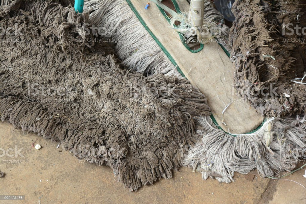 old rag and mops on cement ground stock photo