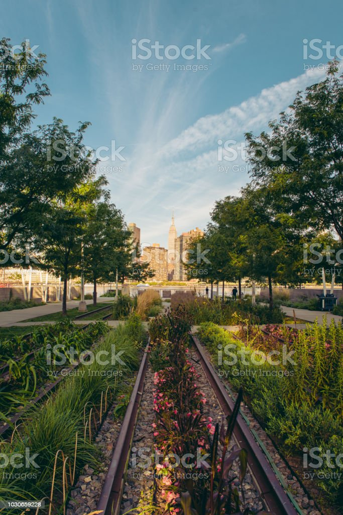 Old Railroad Tracks And View Of New York City Skyline At