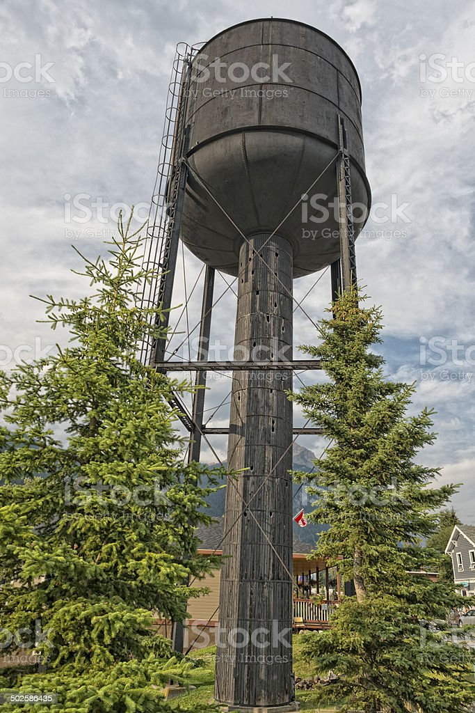 old railroad water tower in field Canada stock photo