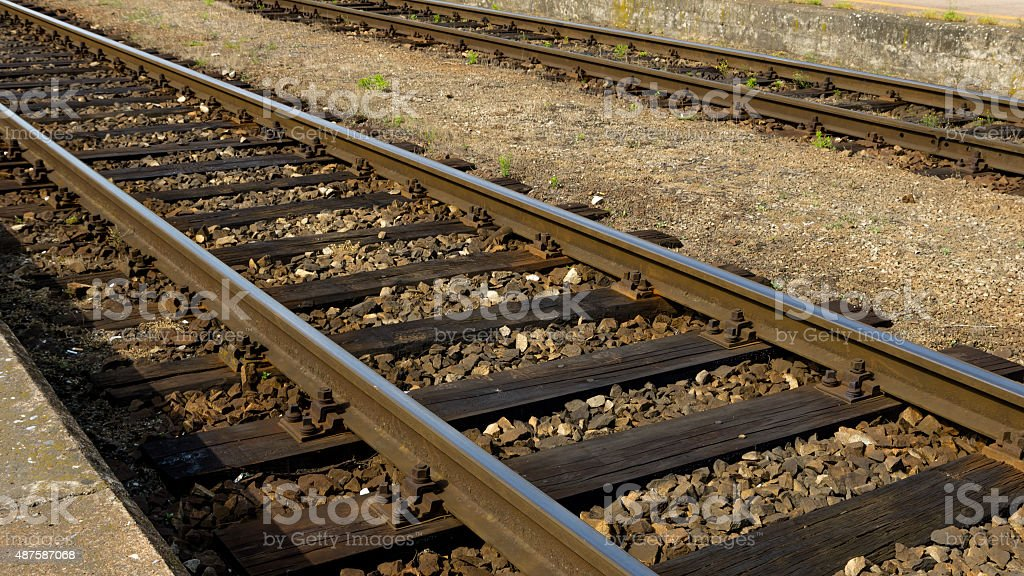 Old rails on the platform stock photo