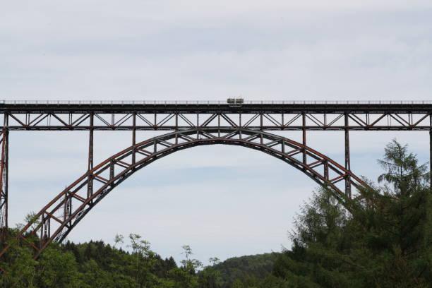 Old railway bridge over a river Old railway bridge railway bridge stock pictures, royalty-free photos & images