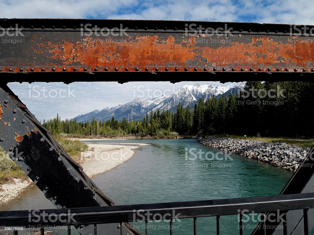 Old railway bridge over Bow River in Canadian Rockies stock photo