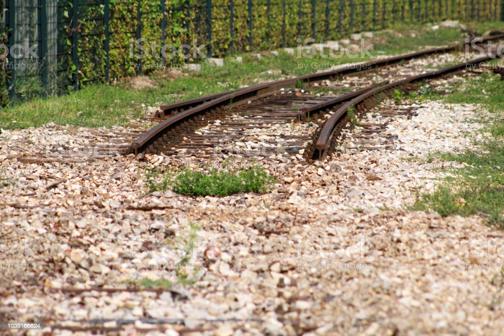 Old railway track in urban city. Vintage railroad. Close view of old...
