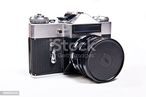 Soviet built range finder camera with 52mm lens. Classic black manual film camera isolated on white background.