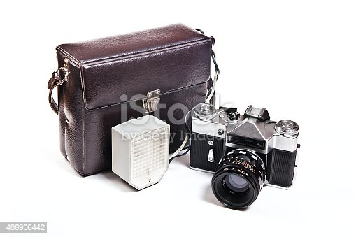 Range finder camera with 52mm lens. Classic black manual film camera isolated on white background.