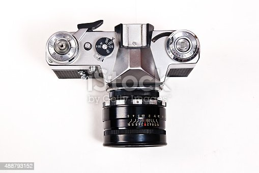 Range finder photo camera with 52mm lens. Classic black manual film camera isolated on white background.