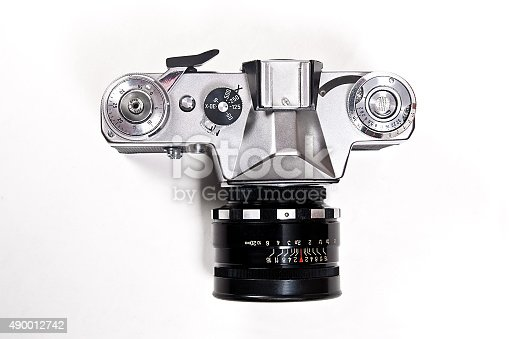 Range finder photo camera with lens. Classic black manual film camera isolated on white background.