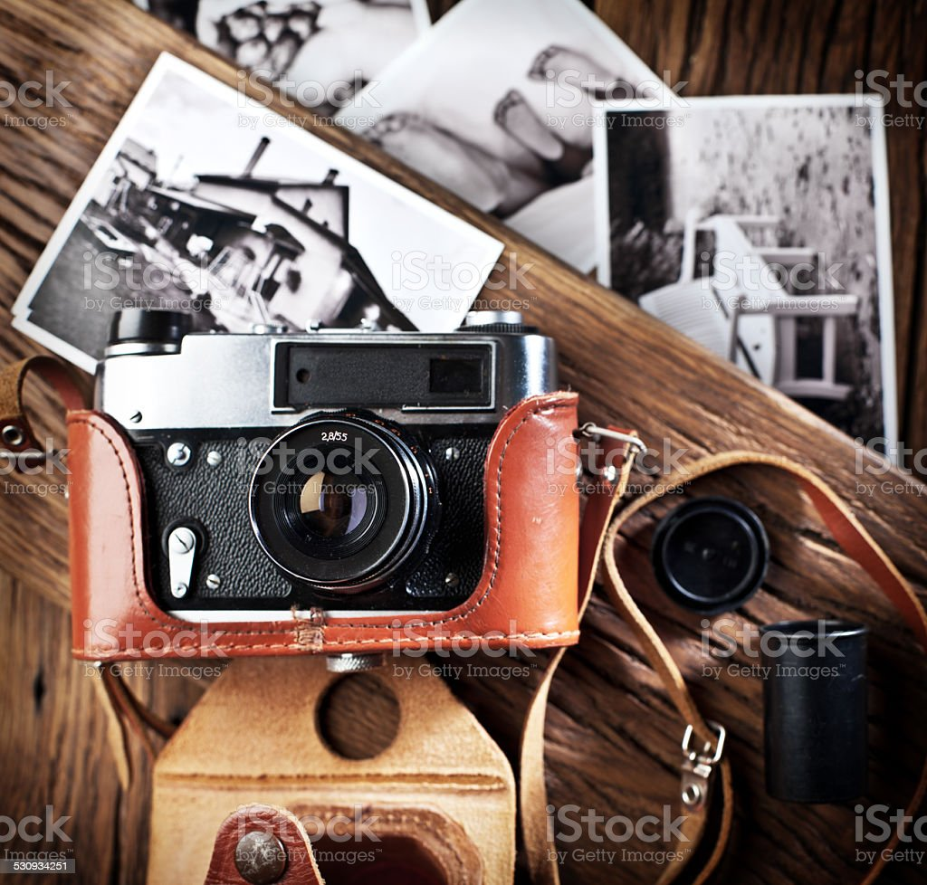 Old rangefinder camera and black-and-white photos. stock photo