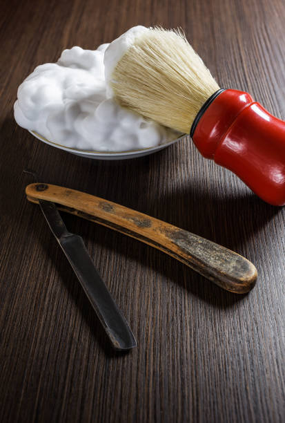 Old razor with shaving brush and foam. Old razor with shaving brush and foam. shaving brush shaving cream razor old fashioned stock pictures, royalty-free photos & images