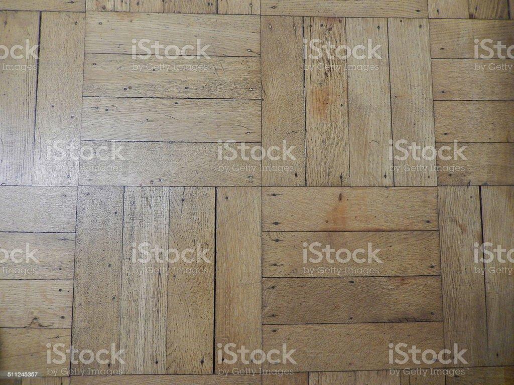 Old, reclaimed varnished parquet floor, wooden parquet flooring, light oak stock photo