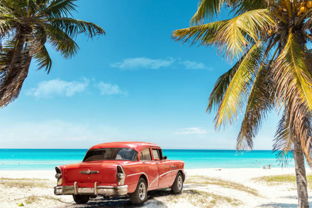 old red american car on Varadero Beach in Cuba stock photo