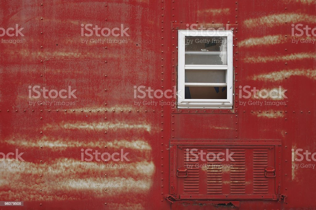 Old red and rusty traincar with white window. royalty-free stock photo