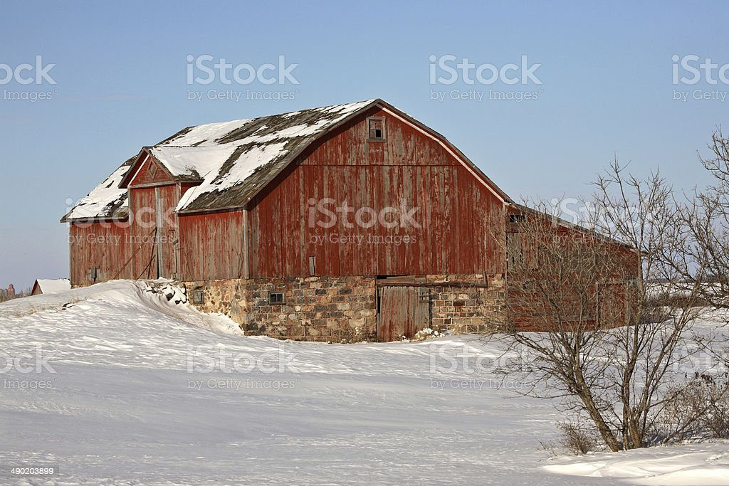 Old red barn in winter stock photo