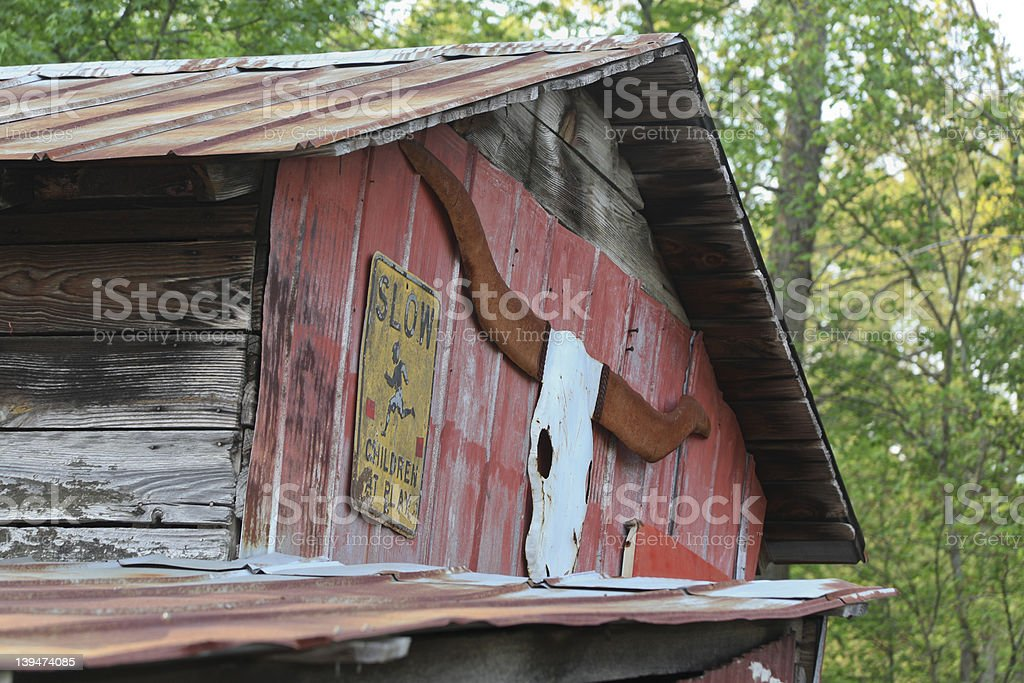 Old Red Barn With Longhorn Plaque royalty-free stock photo