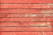 Peeled painted boards in red