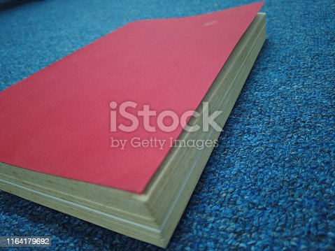 508711370 istock photo old red book in office 1164179692