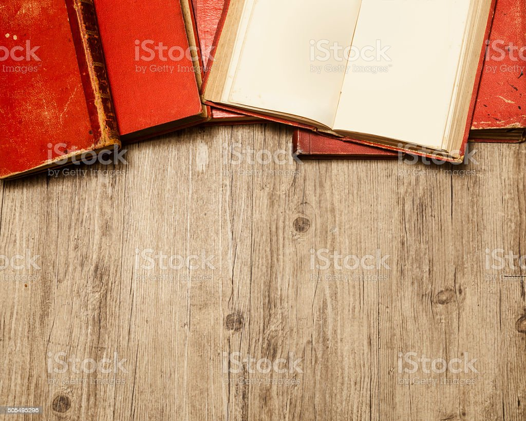 old red books on wood stock photo