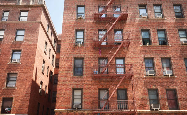 Old red brick building with fire escape, New York City, USA. stock photo