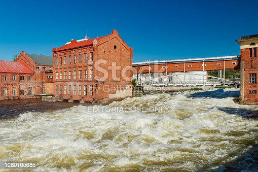 Kouvola, Finland - 15 September 2020: Old red brick buildings of Upm factory on rapids Kuusankoski.