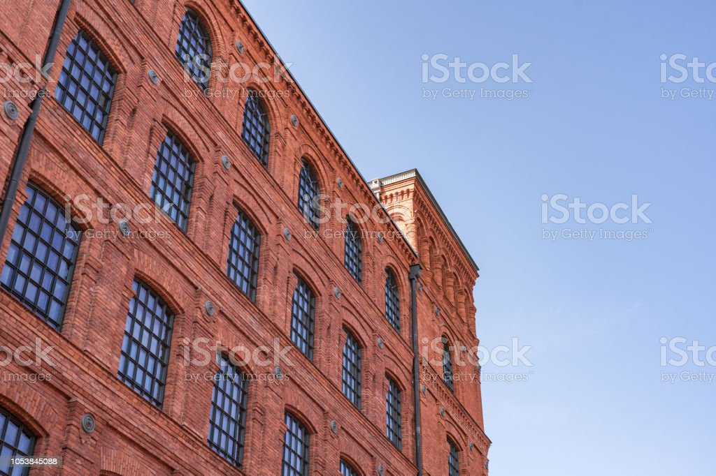 Old red brick tenant house or factory building. stock photo