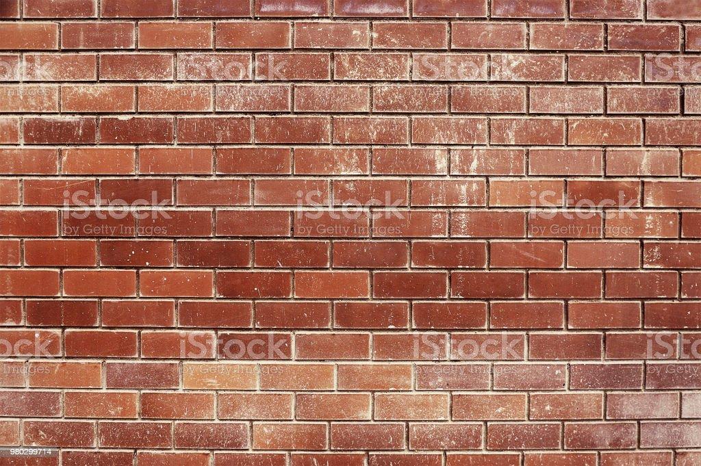 Oude rode bakstenen muur achtergrond foto
