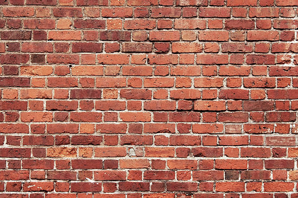 Old red brick wall background texture​​​ foto