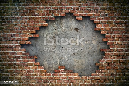 istock Old red brick wall damaged background 1002801182