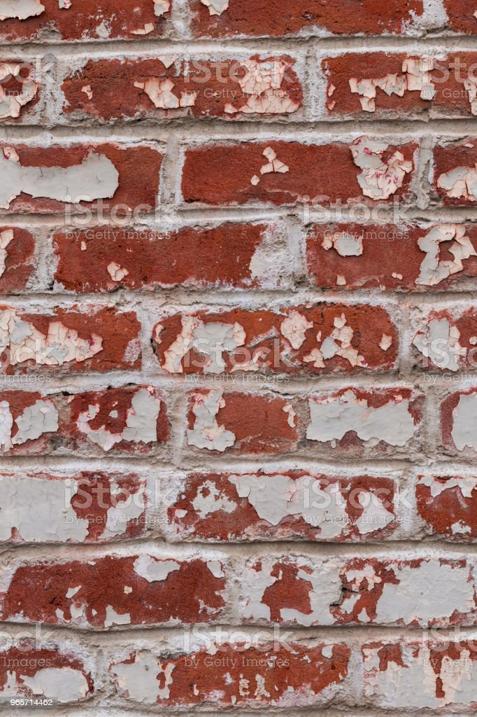 Old red brick wall with peeling paint. - Royalty-free Antique Stock Photo