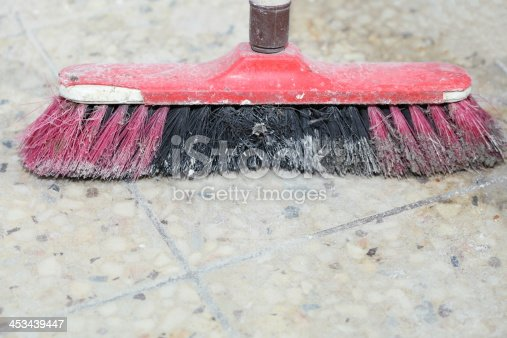 istock Old red broom on construction site 453439447