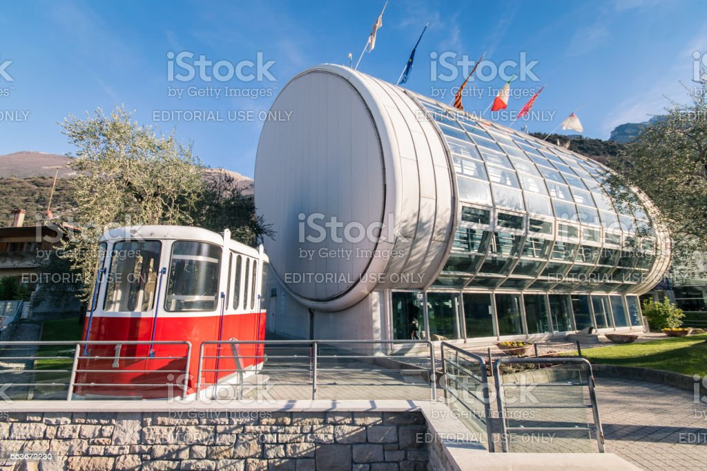 Old red cable car in front of the new cableway Malcesine-Mount Baldo. stock photo
