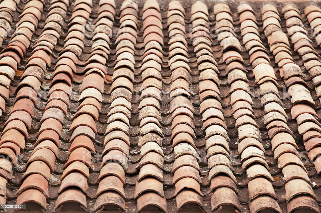 Old red clay tile roof stock photo