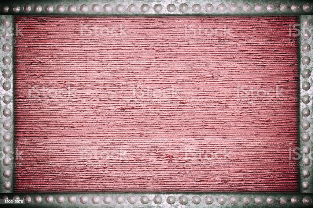 Old red fabric background with metal rivets frame stock photo