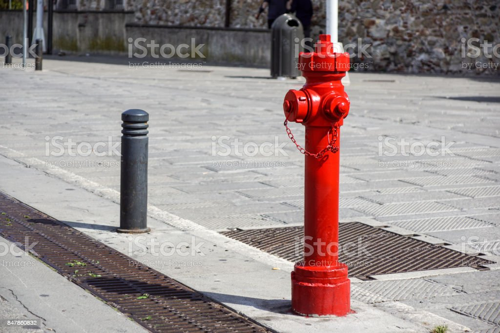 Old red fire hydrant in New York City street. Fire hidrant for...