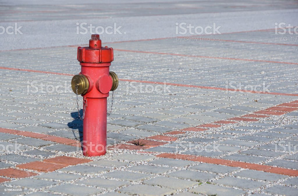 Old red fire hydrant in the street. Fire hidrant for emergency fire...