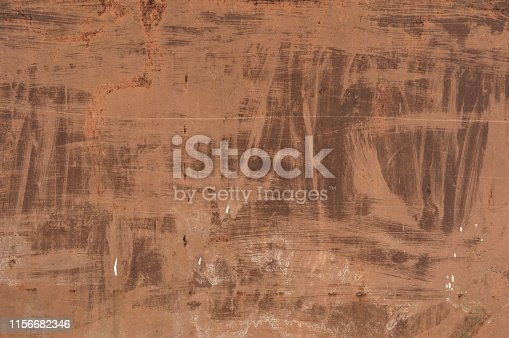 istock Old red metal roof of the building, a lot of damage on the metal, closeup texture or background 1156682346