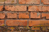 Old red painted brick wall