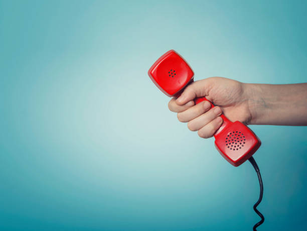 old red phone - using phone stock photos and pictures