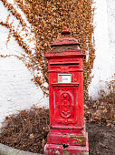 Old red postbox in the Belgian town of Verviers