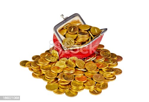 Old red purse with golden coins  isolated on white background