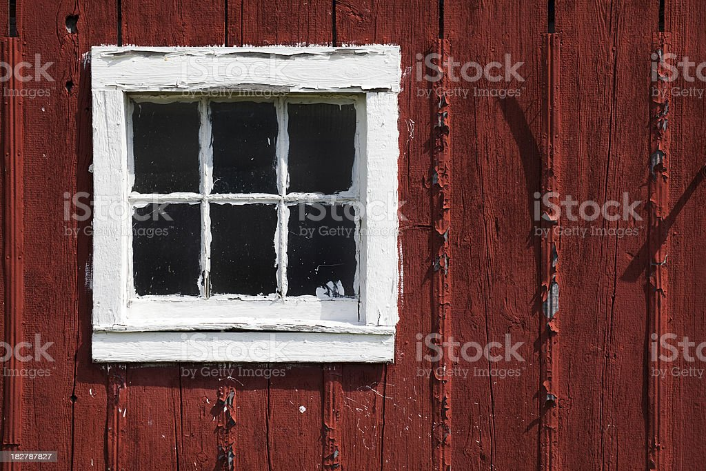 Old Red Rustic Barn Window; World's Worst Paint Job stock photo