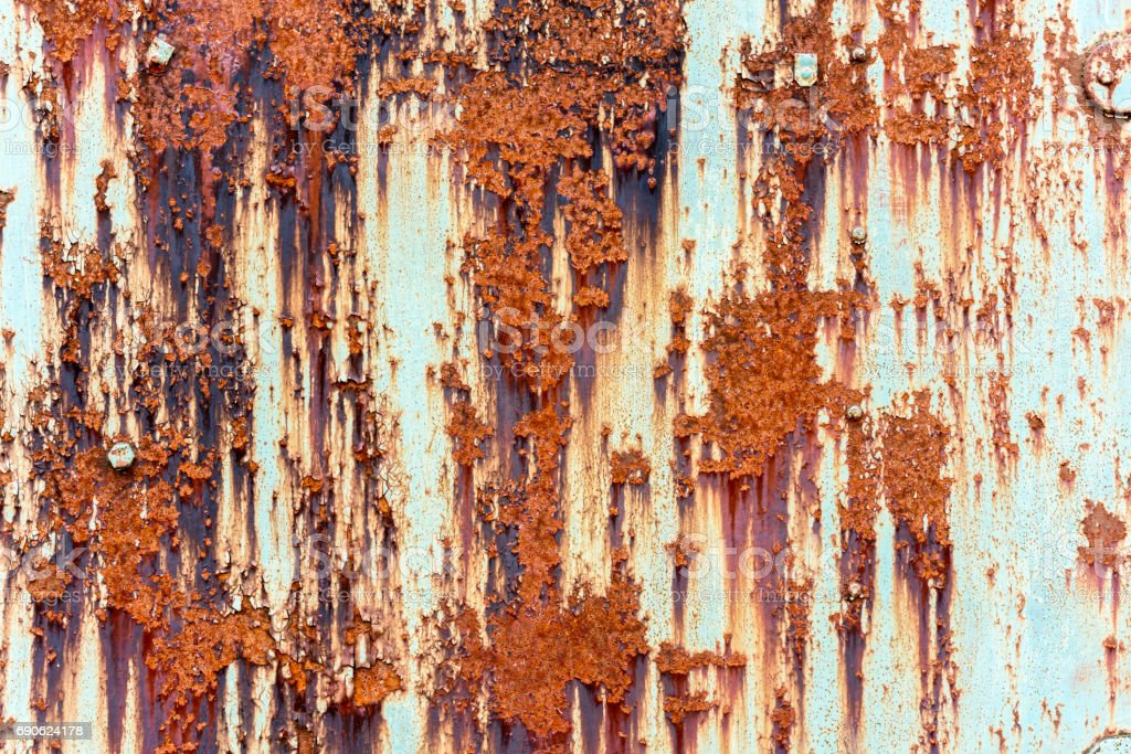 Old red rusty metallic steel plate with flaking paint. stock photo