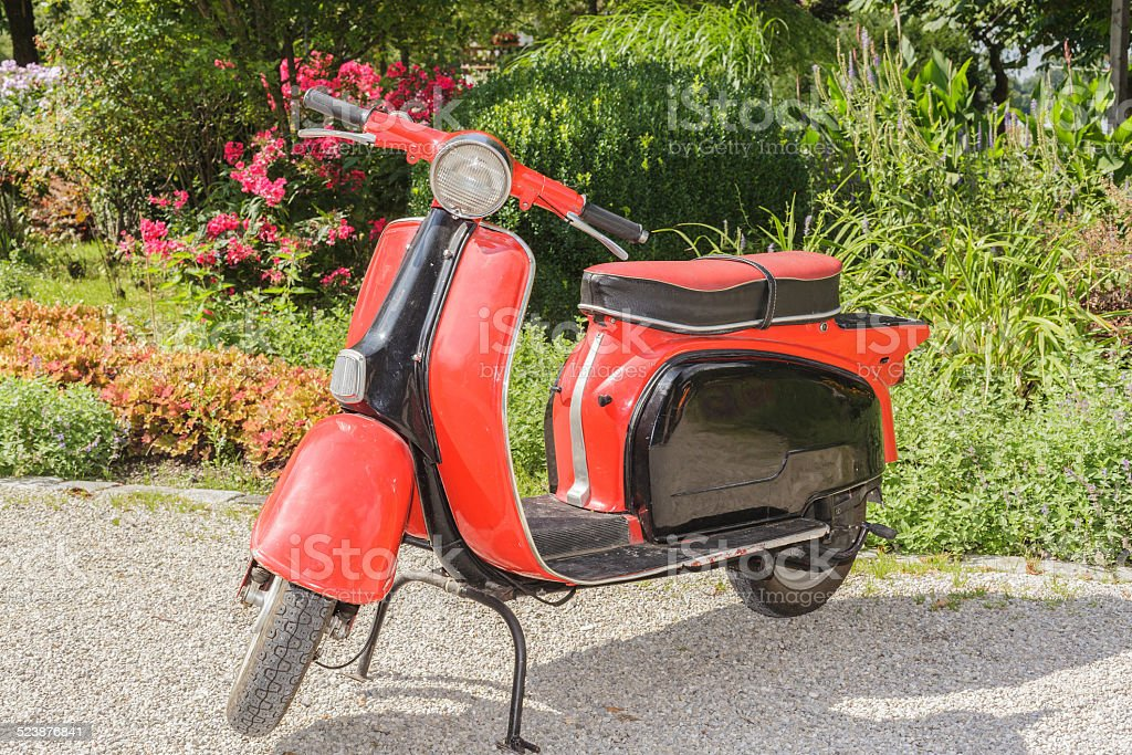 Old red scooter stock photo