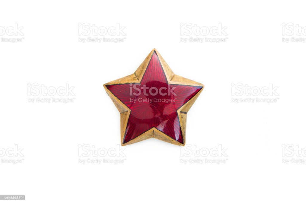 Old red star from military cap isolated on the white background royalty-free stock photo